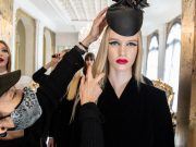 madel getting hat adjusted before fashion show NYFW
