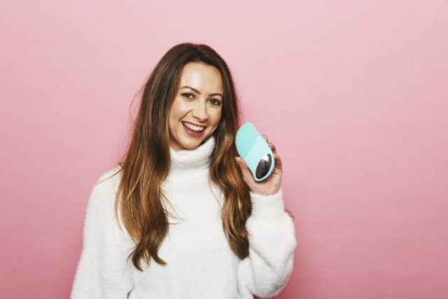 women holding a face care product